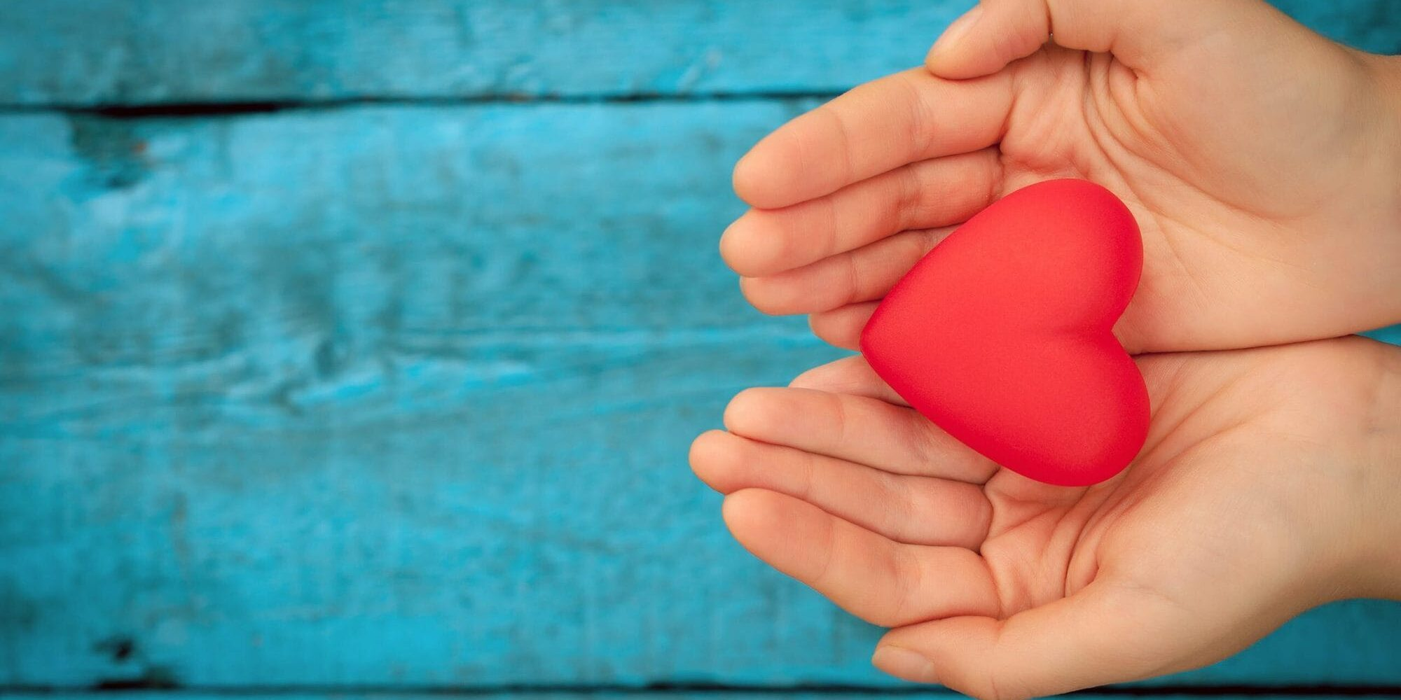 bigstock-red-heart-in-the-hands-114569051